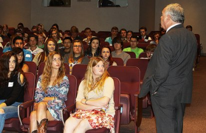 President Woodrow Wilson (portrayed by Dr. Paul Vickery) talks with high school students about his role in World War I